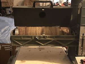 Conveyor belt driven thickness sander