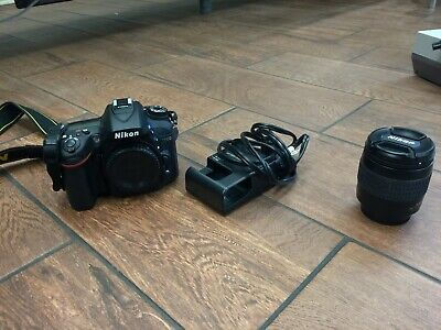 NIKON D7100 CAMERA WITH 28-80MM LENS AND CHARGER