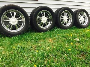 "American racing 20""x8.5 wheels with 305/50/r20 tires"