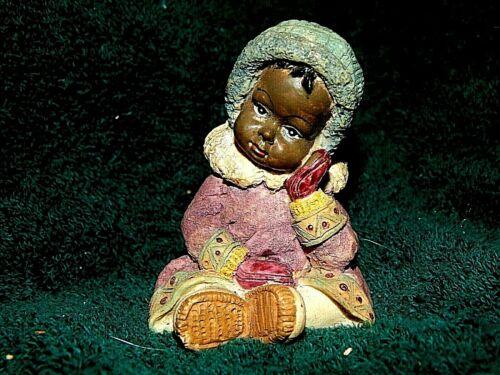 Black Heritage Child in Winter Clothes Figurine