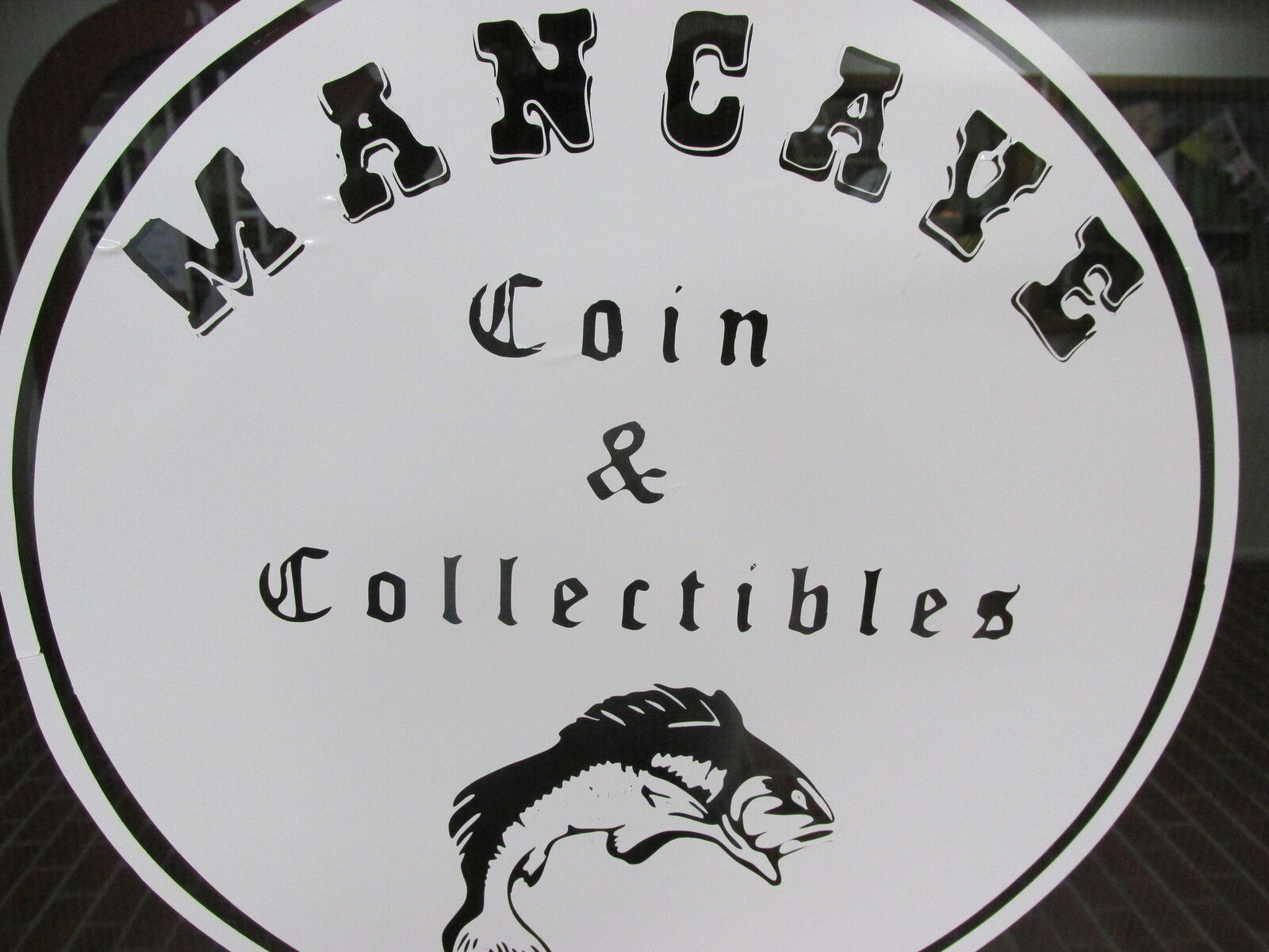 MANCAVE COIN & COLLECTIBLES SHOP