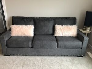 Grey studded couch