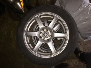 16x7 4 bolt universal rims/tires