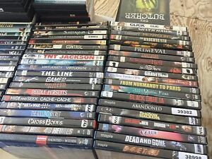 Assorted DVDs for sale.