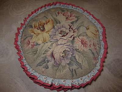 (Blue round throw pillow, needlepoint floral top, pink pleated ruffle, down fill)