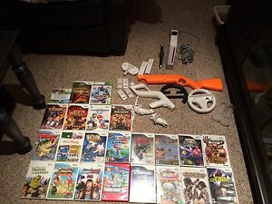 Nintendo Wii with 23 games and accessories