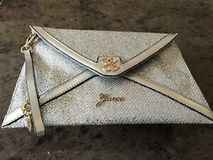 Guess silver evening bag never used