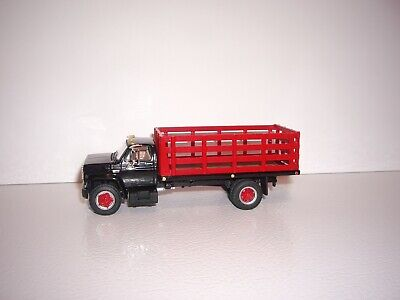 DCP FIRST GEAR 1/64 BLACK CAB RED STAKE SIDE GMC 6500 SINGLE AXLE STAKE TRUCK  1