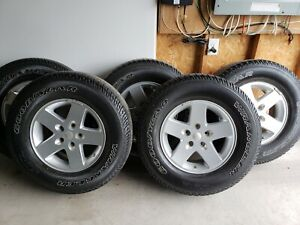 5 Jeep wrangler rims and tires