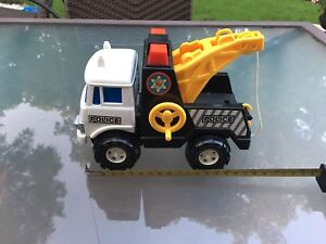 Small toy police tow truck