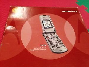 Three Motorola T720 flip phones