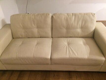 Three seater beige leather sofa for quick sale