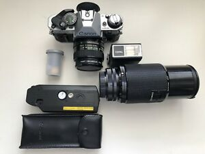 Canon AE-1 + 28mm & 70-200mm lenses with accessories