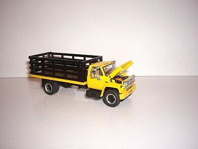 DCP FIRST GEAR 1/64 YELLOW CAB BLACK STAKE SIDE GMC 6500 SINGLE AXLE TRUCK  3