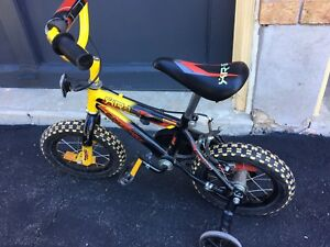 """12"""" wheeled Supercycle with training wheels."""