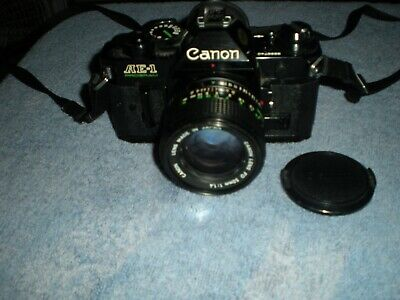 EXCELLENT CANON BLACK AE-1 PROGRAM CAMERA WITH 50MM F1.4 LENS WORKS PERFECT!!!
