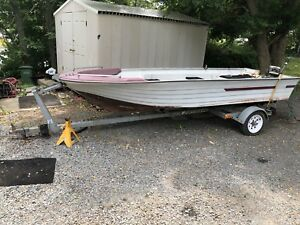 14 ft boat motor and trailer