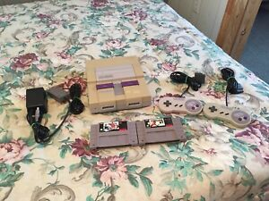 Super Nintendo console, controllers and games