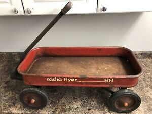 Vintage Radio Flyer metal wagon toy rusted patina. ($40)