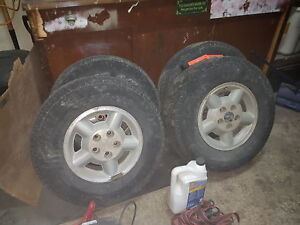 Set of 4 tires and rims off a blazer
