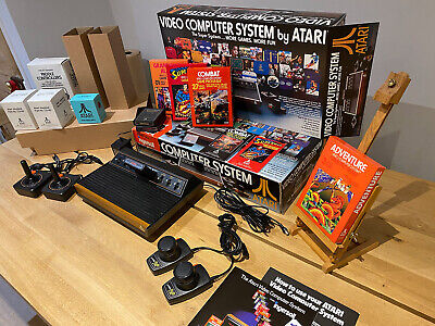 Atari 2600 VCS plus new controllers and games and New repro packaging