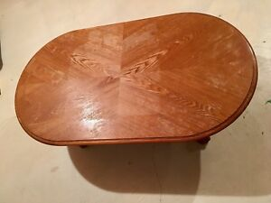 Oval brown wooden coffee table - solid wood