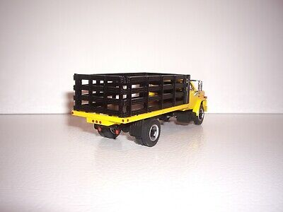 DCP FIRST GEAR 1/64 YELLOW CAB BLACK STAKE SIDE GMC 6500 SINGLE AXLE TRUCK  2
