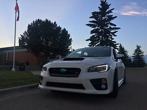 2015 Subaru STI with winter tires + extended warranty.