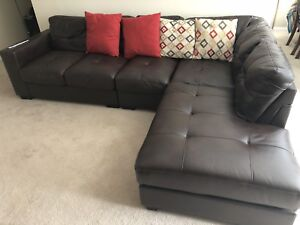 Brown Leather sectional with 4 accent pillows