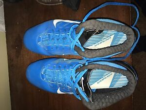Blue Nike cleats
