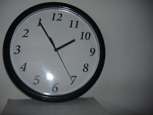 Backwards quartz wall clock runs counter clockwise novelty