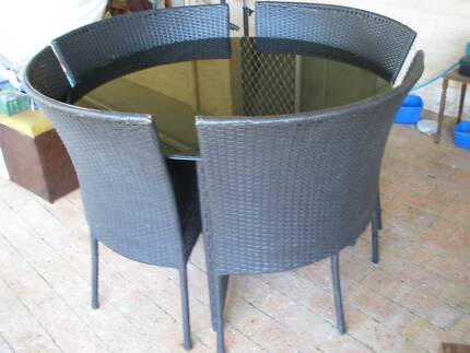 Outdoor setting, sleek round thick black glass table 4 chairs