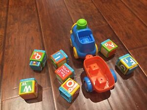 Lot of toddler toys 2 trains and a boat.