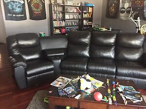 Leather sectional with recliners, cup holders and storage