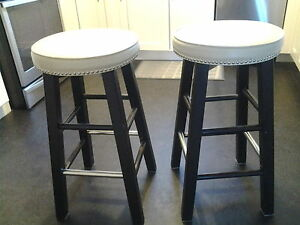bar stools , couch, chair, entertainment unit