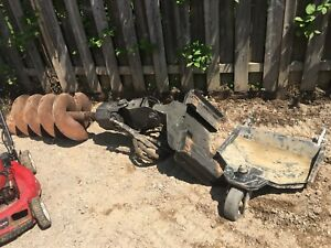 Bobcat mt52 post hole auger and 6 bits