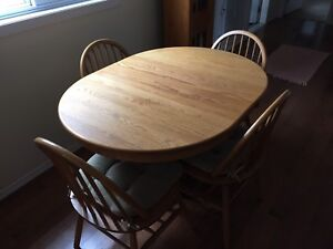 Solid Oak table with 4 chairs.