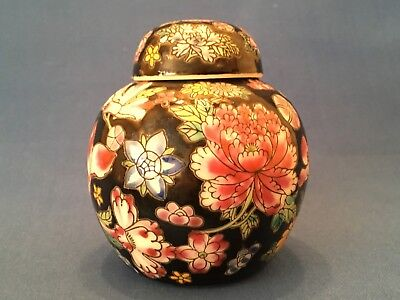 Chinese Ginger Jar and Lid in Relief with Black Background Handpainted Flowers