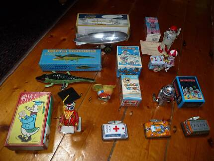 Collection of wind-up tin toys