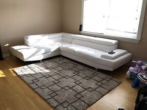 White faux leather sectional couch