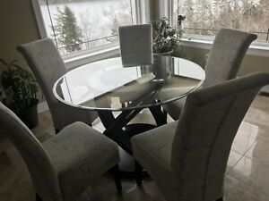 Round glass table and 6 chairs for sale,