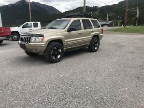 2001 JEEP GRAND CHEROKEE LTD LIFTED & WHEELS
