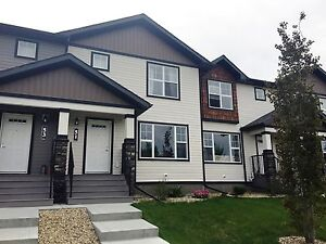 CALL US NOW!  3 bed modern and vibrant townhouse in Sylvan Lake!