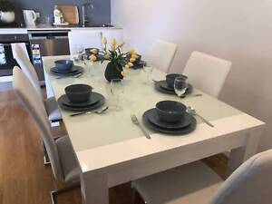 URGENT! Dining table in brand new condition with 4 year warranty