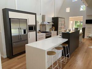 Large kitchen with white quartz ceasarstone bench top