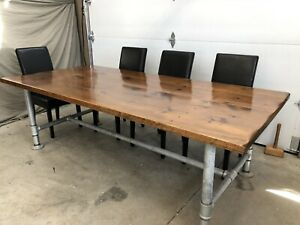 Rustic dining table with pipe base