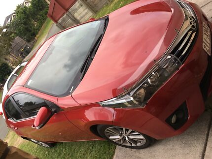 Toyota Corolla red 2014 sedan 25kms $14800 negotiable