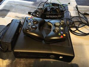 Xbox 360 with Afterglow Wired Headset and controllers