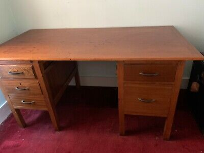 Vintage wooden desk with drawers
