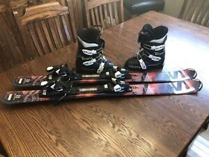 Boys skis, boots and poles
